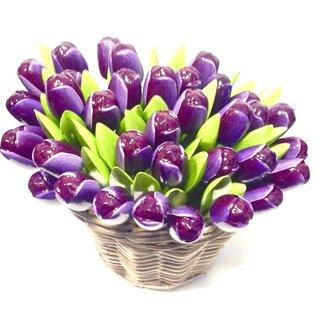dark purple wooden tulips in a wicker basket