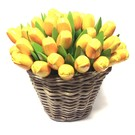 yellow wooden tulips in a wicker basket