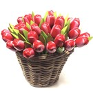 Red - white wooden tulips in a wicker basket