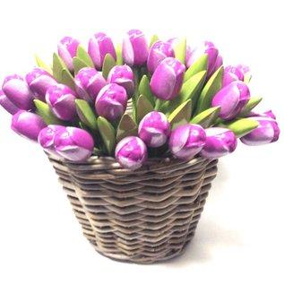 Purple wooden tulips in a wicker basket