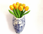 small wooden tulips in a wall vase