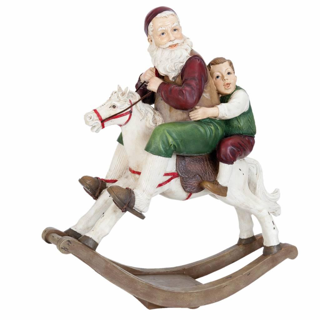 Wohnaccessoires Landhausstil Weihnachtsmann auf Schaukelpferd 45x18x50