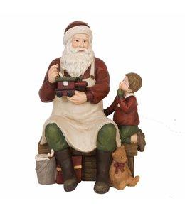 Landhaus Weihnachtsmann mit Junge