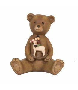 Teddybär mit Schaukelpferd