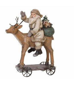 Landhaus Weihnachtsmann auf Rentier
