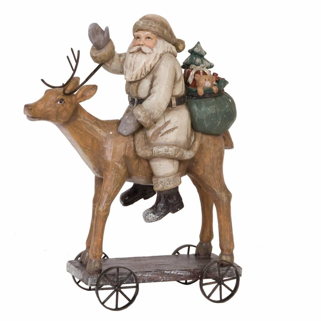 Wohnaccessoires Landhausstil Weihnachtsmann auf Rentier