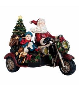 Landhaus Weihnachtsmann auf dem Motorrad