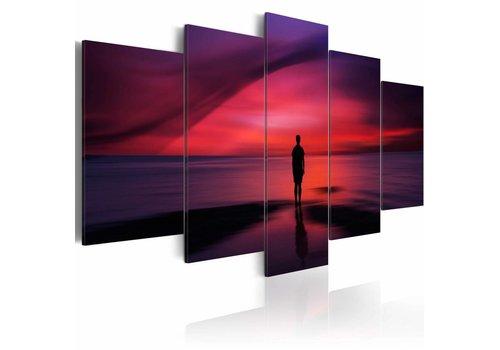 Schilderij - Een man het bewonderen van de zonsondergang