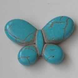 Vlinder kraal Geperst steen dyed Tuqoisekleurig. 25x35mm.