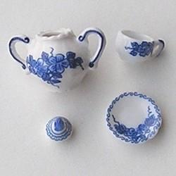 Porceleinen suikerpotje en kop en schotel.