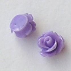 Kunststof bloemetje met platte onderkant. Lila. 10mm. Leuk als cabochon te gebruiken.