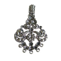 Metal openwork pendant 44 x 28mm. Silver-colored