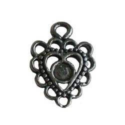 Metal openwork pendant 15x20mm. Silver-colored