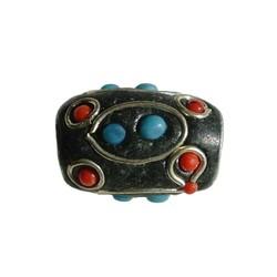 Kashmiribead 13x17mm. Rood blauw met groot gat. Ovaal