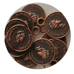 Coin Charm 14x17mm. Copper colored red.