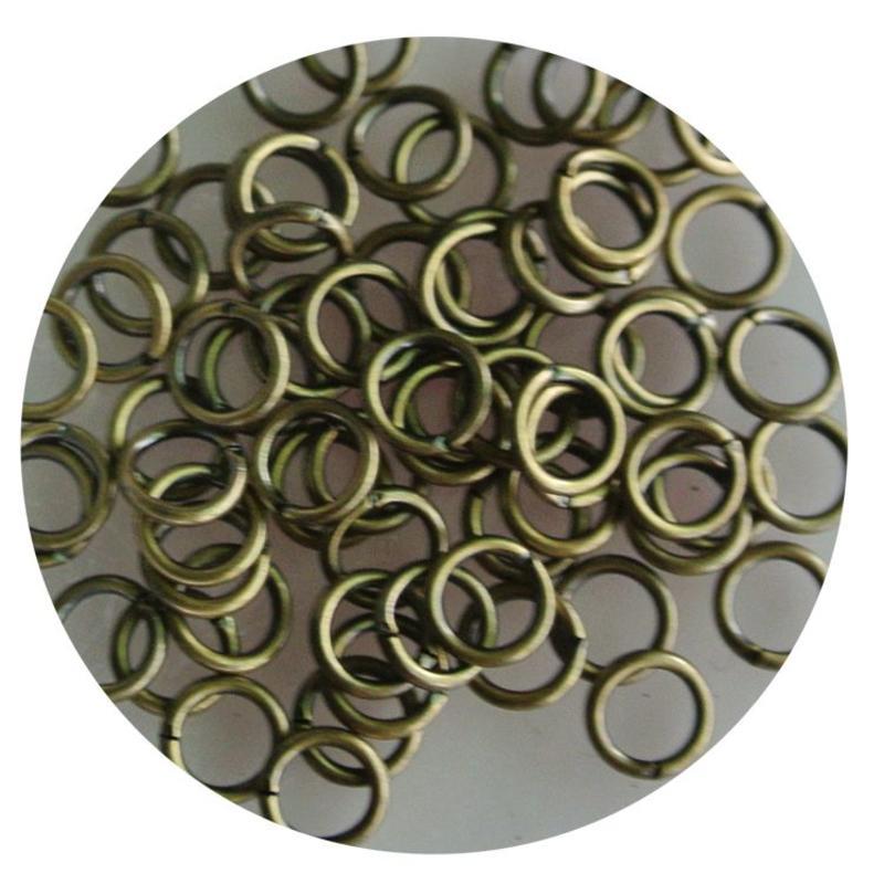 Aanbuigringetjes. 5mm. Bronze. bag of 100 pieces for