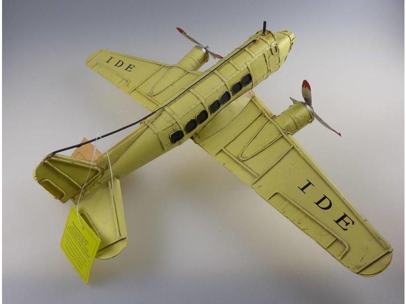 Reinhart Faelens Kunstgewerbe Flugzeug aus Blech, Dekoration, Passagierflugzeug gelb 30x41x11 cm
