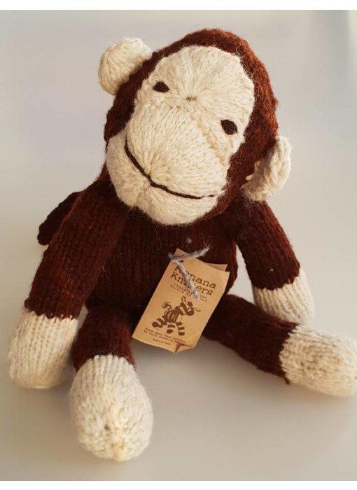 Sitzender Woll-Affe in weiß/braun