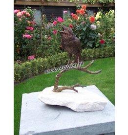 Beeld brons vogel op tak