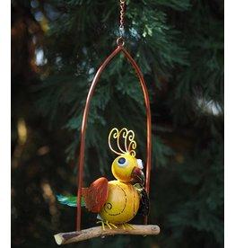 Metalen vogel in schommel 1