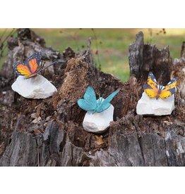 Farbige Schmetterling auf Stein Bronze