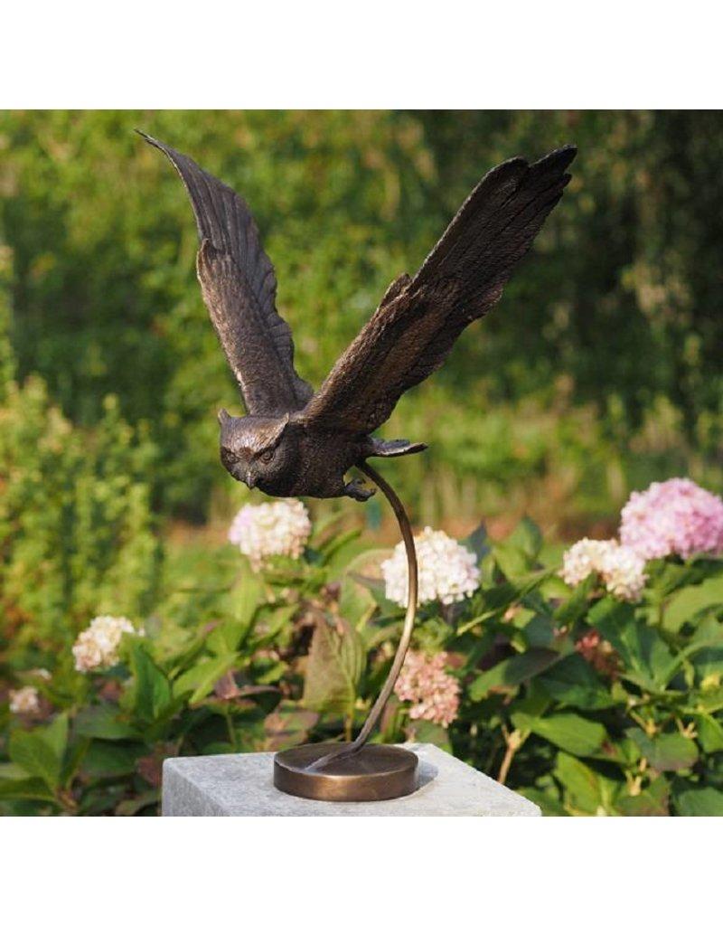 Bronze fliegende Eule