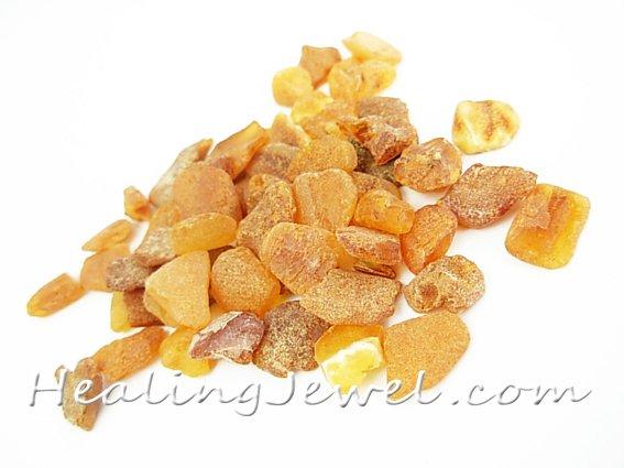 ruwe steentjes oranje amber/barnsteen, ongeveer 1,5 gram totaal