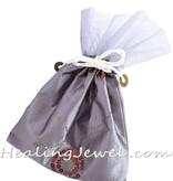satijnen zak met 250gr. hematiet trommelstenen
