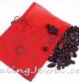 satijnen zak met 250gr. granaat trommelstenen