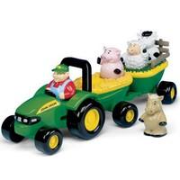 Muzikale tractor met aanhanger en dieren Britains