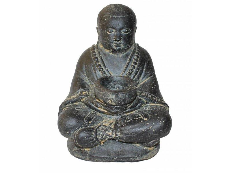 Shaolin monnik met waxinelichthouder