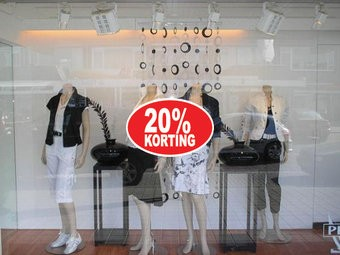 """Ovale """"20% korting"""" Sticker auf Niederländisch"""
