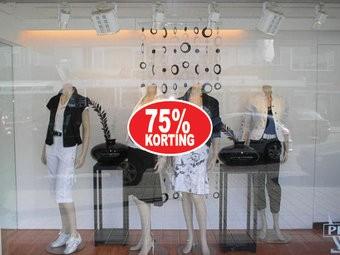 """Ovale """"75% korting"""" Sticker auf Niederländisch"""