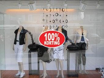 """Ovale """"100% korting"""" Sticker auf Niederländisch"""