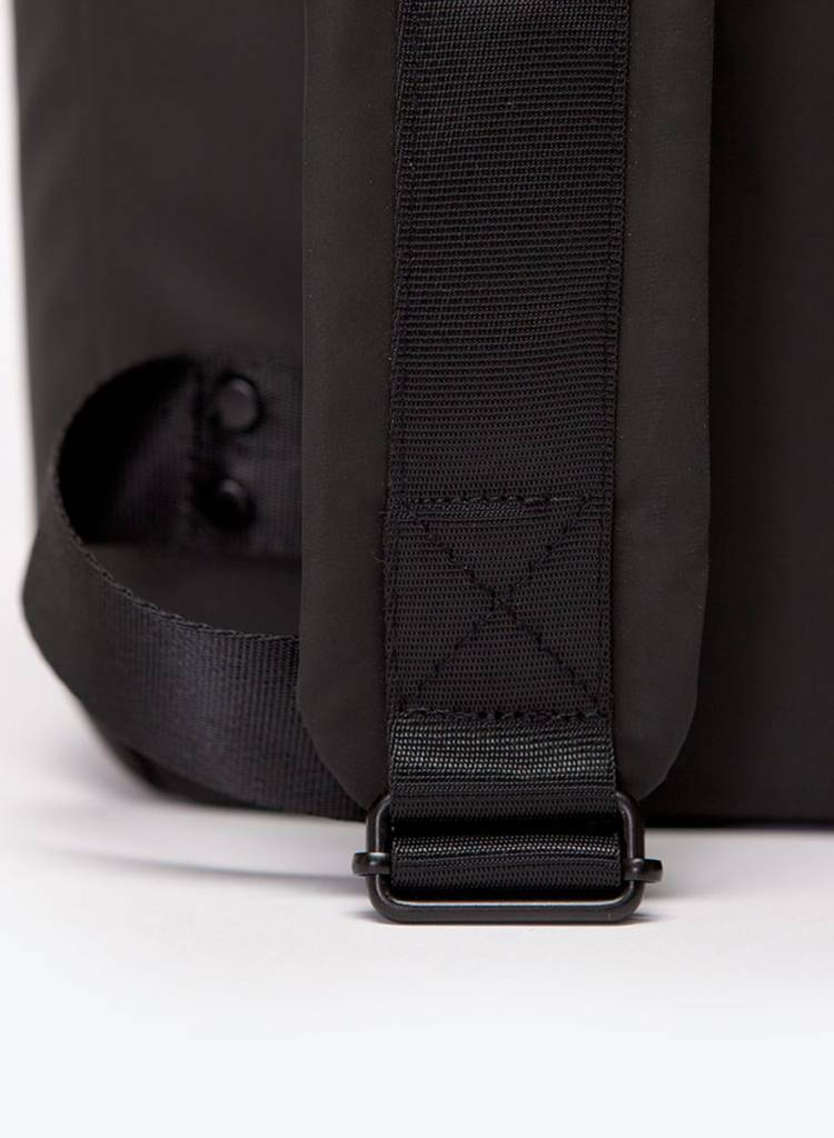 "Ucon Acrobatics  Backpack ""Alan"" Black (Lotus Series) - Shell material made of rubberized PVC"