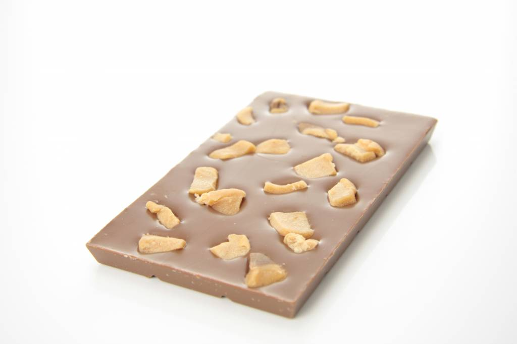 A bar of milk chocolate with pieces of caramel
