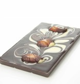 A dark chocolate bar with chocolate sea shells