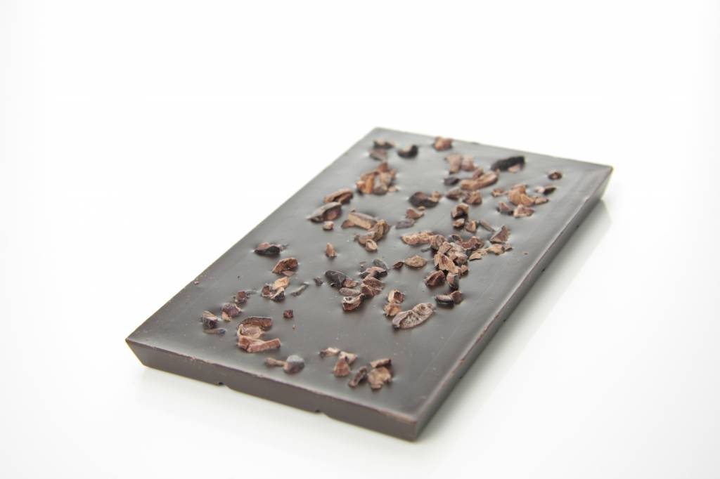 A dark chocolate bar with cocoa nibs