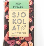 A bar of dark chocolate with a mix of red fruits
