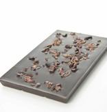 A dark chocolate bar 90% cocoa with cocoa nibs