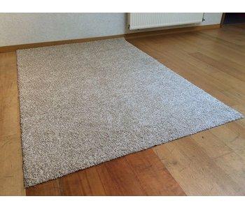 Beige frisé tapijt