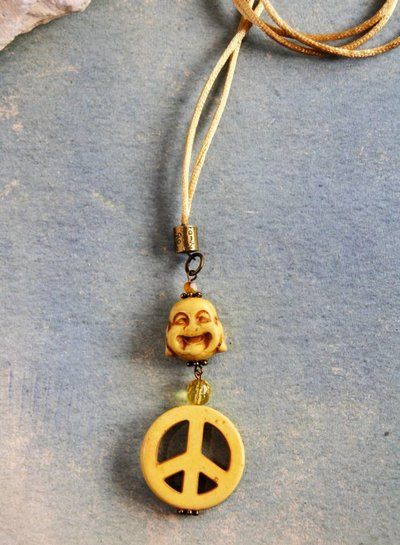 HanneHaves Ibiza ketting  Yellow laughing Buddha