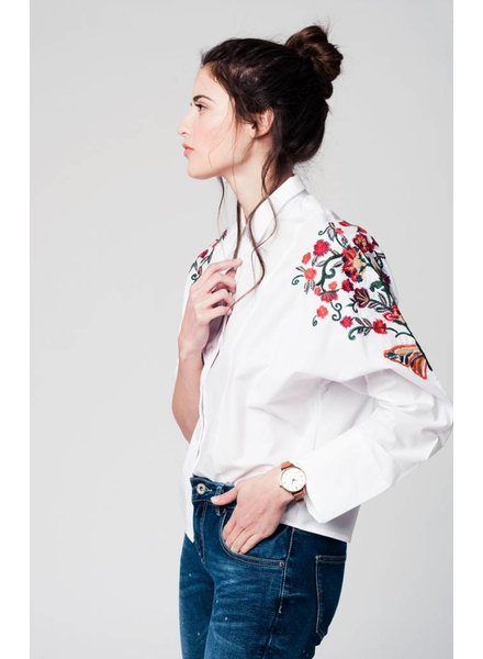 White blouse with flower embroidery