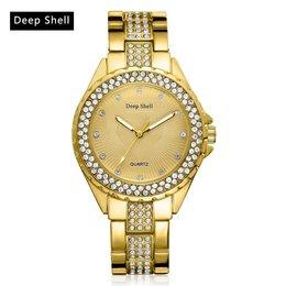 Trendy dames horloge met ronde scherm goud kleur kristalen