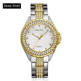 Trendy dames horloge ronde scherm zilver met goud versierd met kristalen
