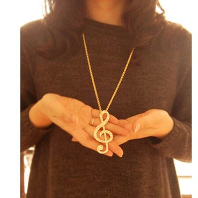Trendy lange ketting met G muziek sleutel gouden kleur kristalen