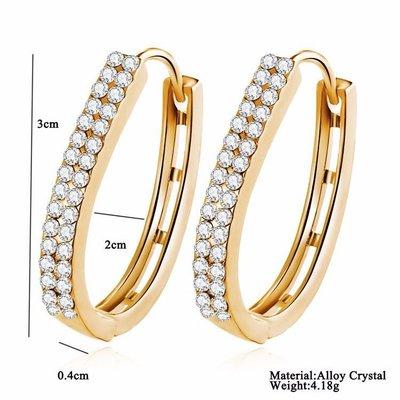 Goud kleur versierd met 2 rij kristallen oorbellen