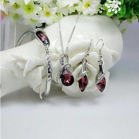 Sieraden set oorbellen met armband en ketting versierd met wit donker rode kristal