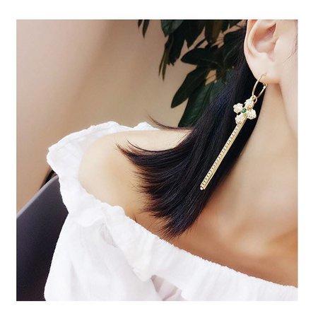 Statement oorbellen gouden kleur kwastjes met bloem kleine kristalen