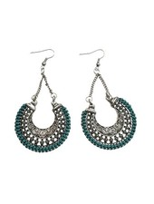 Long turquoise crescent-shaped statement earrings